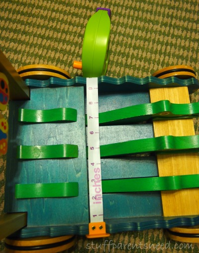 child's tape measure measuring a toy