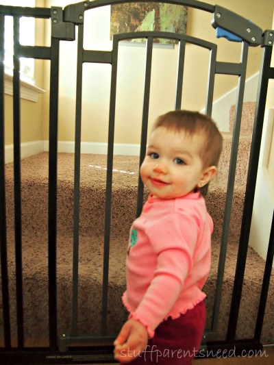 baby standing at the best baby gate from The First Years