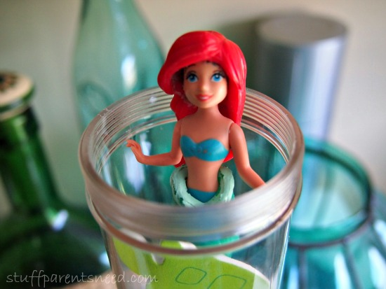 mermaid sticking out of a clear tube. Sensory for toddlers