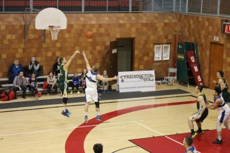 Tommies guard Travis Valanne lets it fly from the three point line.