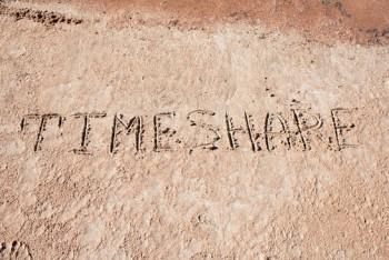 "Inscription ""TimeShare"" on a sand."