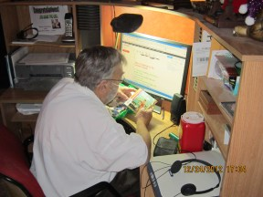 Dad at his computer with a new CD in 2012.