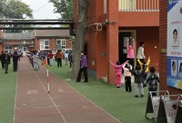 The way to the theater leads past a schoolyard, where the children stand in line every morning