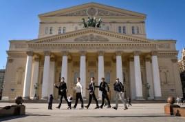 Jesse Fraser, Robert Robinson, James Fisher, Özkan Ayik and Alexander MacGowan jumping for joy in front of the Bolshoi