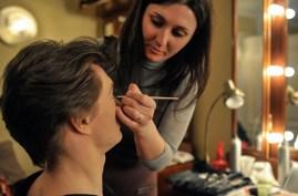Lola Khourramova applies Alexander Zaitsev's makeup before his performance as Mercutio