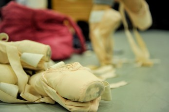 A bunch of pointe shoes in the studio.