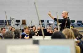 Our Music Director James Tuggle in a rehearsal with the whole orchestra