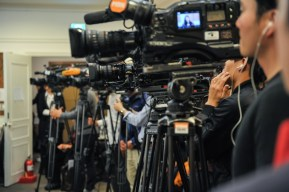 Television cameras at the press conference.