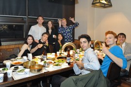 The company enjoying Korean barbecue.