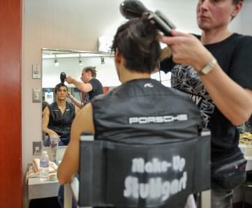 Makeup artist Roman Rädcher prepares Daniel Camargo for the role of Mercutio
