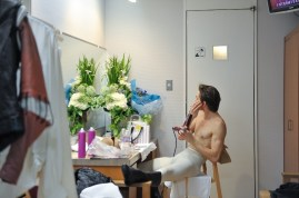 Friedemann Vogel during the intermission, reapplying make up and drying his hair