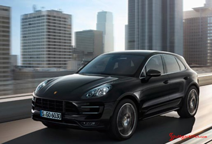 2013 LA Auto Show Porsche Macan world debut: The 2015 Porsche Macan seen in black, from the left-front view, on a downtown L.A. bridge. Source: PCNA