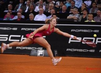 Porsche Ambassador Angelique Kerber is seen here in action on the tennis court, with a splash of Porsche logos in b.g. Credit: Porsche AG