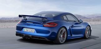 The new Porsche Cayman GT4: The newly introduced (in Feb-15) Cayman GT4, in blue, is pictured here from the right-rear side view, on a desert road. Credit: Porsche AG