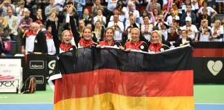 Porsche Team Germany in Fed Cup semi-final: Seen here is the triumphant Porsche Team Germany team holding a large flag of Deutschland at Porsche Arena, 2015, after defeating Australia, now moving on to the Fed Cup Semi-Finals. Credit: Porsche AG