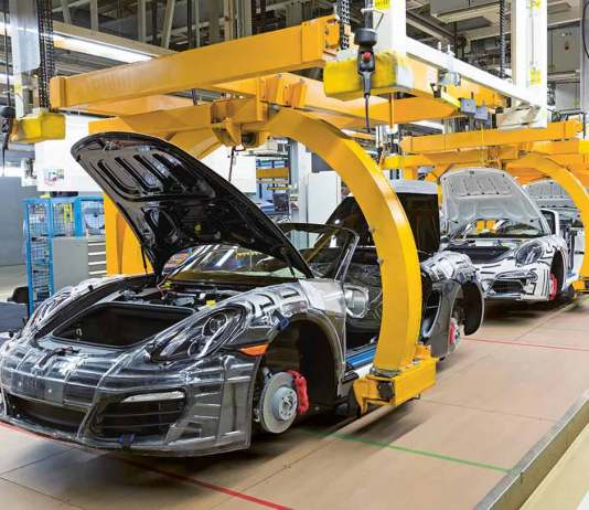 Porsche makes 2015 factory investments: Seen here is a Boxster assembly line in Porsche's Zuffenhausen plant, each car cradled by a yellow lift moving down the line. This exemplifies Porsche's plans to become Fit for the Future. Credit: Porsche AG