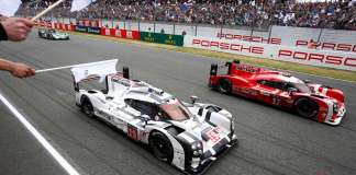 Seen here are the Porsche LMP1 919 No. 17 and No. 19 on track between the straightaway grandstands, at Le Mans, 2015. Credit: Porsche AG
