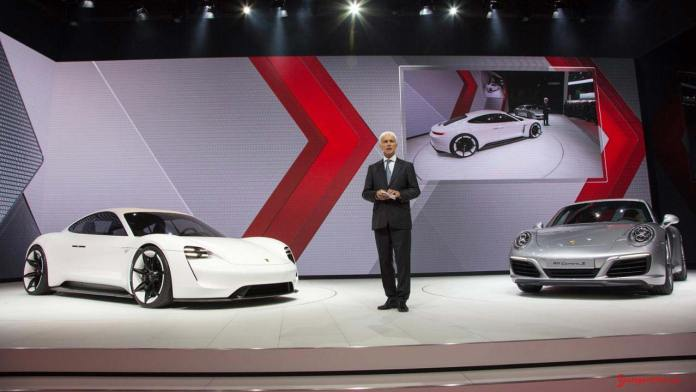 2015 Porsche year in review: CEO Matthias Muller with Mission E and 991 Carrera S at 2015 IAA, Frankfurt. Credit: Porsche AG