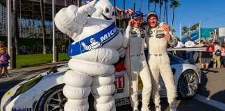 Porsche 911 RSR wins 2016 IMSA Long Beach race: Patrick Pilet and Nick Tandy posing with the Michelin Man in front of their No. 911 Porsche 911 RSR after winning their GTLM class at the 2016 Long Beach IMSA Weathertech SportsCar Championship, round 3. Credit: Porsche AG