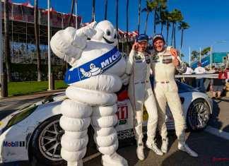 Porsche 911 RSR wins 2016 IMSA Long Beach race: Patrick Pilet and Nick Tandy posing with the Michelin Man in front of their No. 911 Porsche 911 RSR after winning their GTLM class at the 2016 Long Beach IMSA Weathertech SportsCar Championship, round 3. Credit: Porsche AG