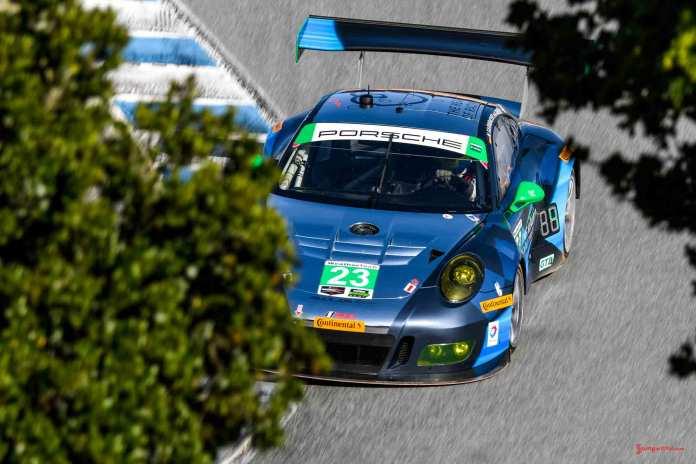 New 2016 Porsche 911 GT3 R wins first race: No. 23 GT3 R on Corkscrew between oaks at 2016 Laguna Seca. Credit: Porsche AG