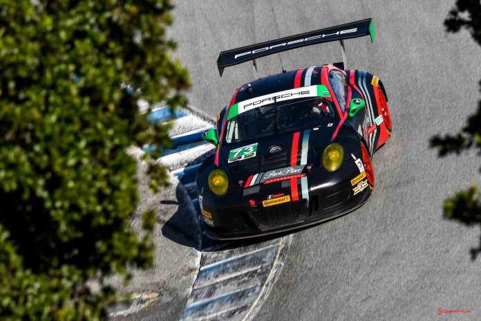 New 2016 Porsche 911 GT3 R wins first race: No. 73 GT3 R on Corkscrew between oaks at 2016 Laguna Seca. Credit: Porsche AG