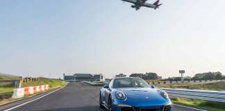 Porsche November 2016 USA sales: Porsche EPC Atlanta 911 on track and airliner in bg. Credit: PCNA