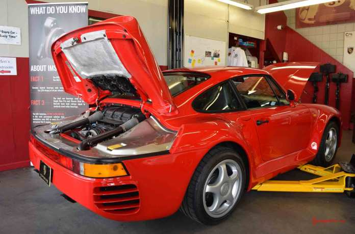 2017 Porsche L.A. Literature, Toy and Memorabilia Meet Weekend: Seen here is a very fine red 959, left-rear, at in the far-left service bay at Callas Rennsport. Credit: StuttgartDNA