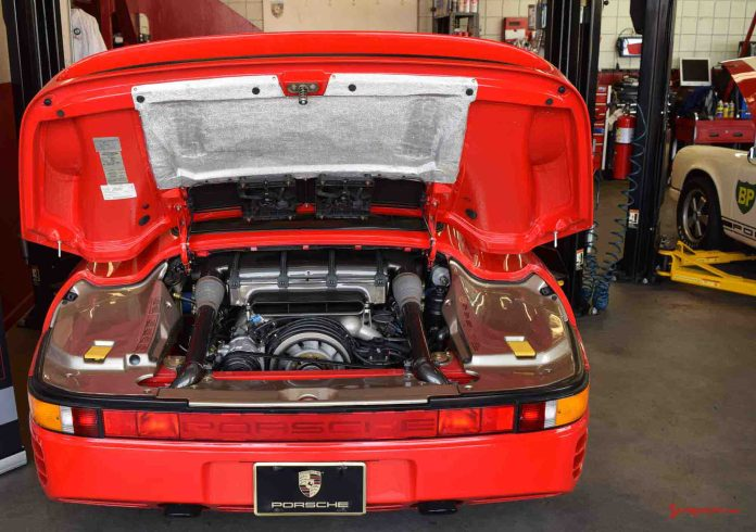 2017 Porsche L.A. Literature, Toy and Memorabilia Meet Weekend: Red Porsche 959 engine bay seen here at Callas Rennsport Open House in the far-left service bay during the 2017 Porsche Lit Meet Weekend. Credit: StuttgartDNA