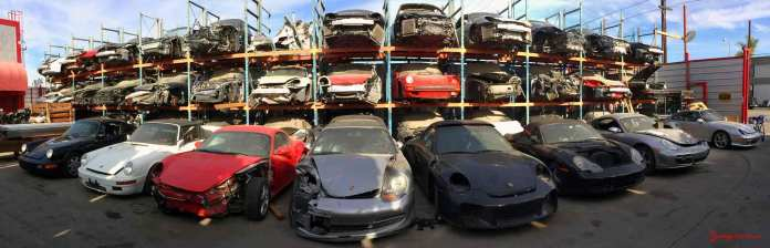 Annual L.A. Lit Show:: LA Dismantler pano of 3 stacked Porsche wrecks in the junkyard. Credit: Los Angeles Dismantler