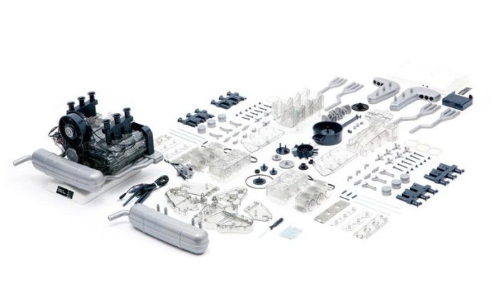 Franzis' Porsche Flat-Six Engine Scale Model Kit: The 911 model engine is seen here both assembled and in all of its pieces systematically laid out. Credit: Flat Six Fanatics