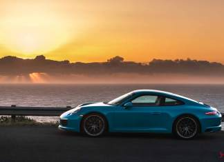Porsche April 2017 USA Sales: Seen in the pretty shot is a Miami Blue Carrera, left side, at sunset. Credit: PCNA
