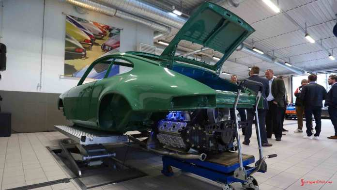 Porsche Classic Centers opening worldwide - Seen here is a classic green 911, its engine lowered from its bay, at the opening of the new Porsche Classic Center Son, Norway. Credit: Porsche AG