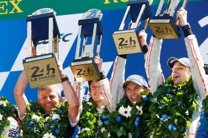 Porsche 2017 Le Mans 24 hat trick – 19th overall win: Enzinger and No-2 winning team of Hartley, Bernhard and Bamber on podium lifting trophies. Credit: Porsche AG