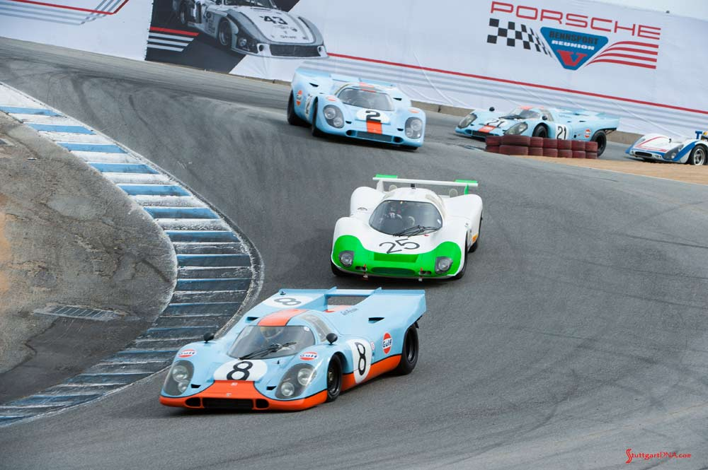 Porsche unveils official Rennsport Reunion VI poster - Rennsport Reunion V: We see here Porsche Gulf-liveried 917s and other Porsche racecars winding down Laguna Seca's famed Corkscrew at the 5th Reunion. Credit: Porsche AG