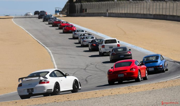 Rennsport Reunion V: Here's a shot of bumper-to-bumper PCA lunchtime attendee parade laps. Credit: Porsche AG