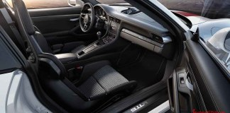 May 2018 Porsche USA sales - We're looking into the sumptuous but minimalist interior of a gleaming Porsche 911R from outside of the passenger's open door.