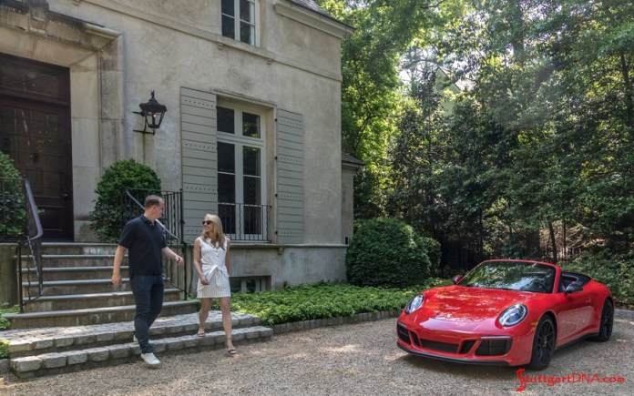 "What are ""Porsche Drive"" and ""Porsche Host""?: Seen here is a semi-generic photograph of a couple exiting to a red 911 Cabriolet, top down, from a Georgia mansion. Credit: Porsche AG"