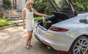 "What are ""Porsche Drive"" and ""Porsche Host""?: We see a pretty blonde in this image, fetching groceries from the trunk of a light-colored Panamera. Credit: Porsche AG"