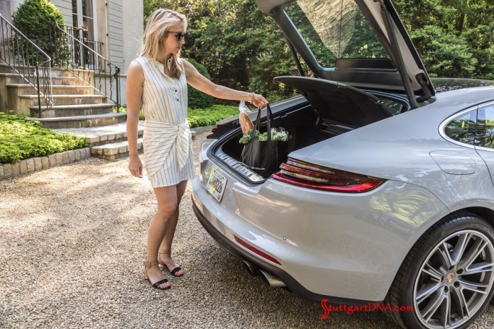"""What are """"Porsche Drive"""" and """"Porsche Host""""?: We see a pretty blonde in this image, fetching groceries from the trunk of a light-colored Panamera. Credit: Porsche AG"""