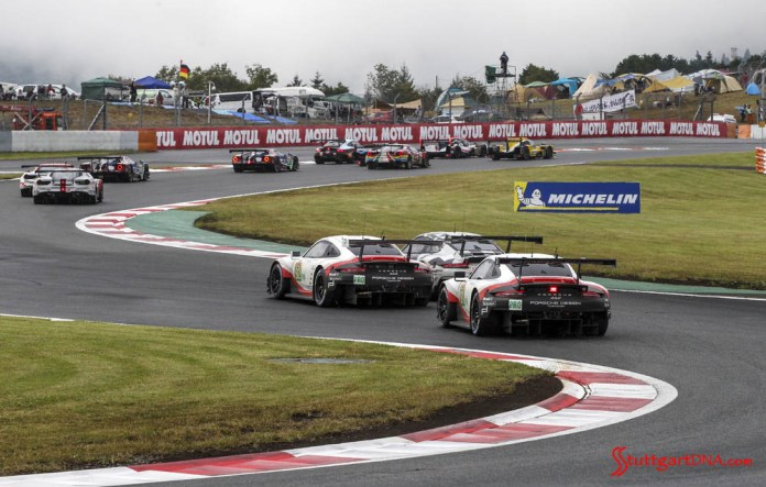 Porsche wins 2018 WEC Fuji 6 Hours: Pictured here ar the Nos. 91 and 92 Porsche 911 RSR battling traffic in the Sss's. Credit: Porsche AG