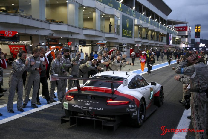Pictured here is the Porsche pit crew cheering the victorious No 92 parading down pit lane at WEC Fuji 6 Hrs Credit: Porsche AG