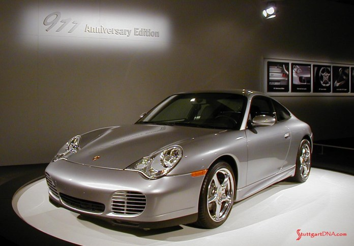 996-gen Porsche 911 Buyer Guide: Depicted here is an Arctic Silver Porsche 996 40th Anniversary Edition specimen, left-front, as exhibited at the 2004 L.A. Auto Show. It memorializes the 40th anniversary of the introduction of the 911 (aka the 901). Credit: StuttgartDNA.com