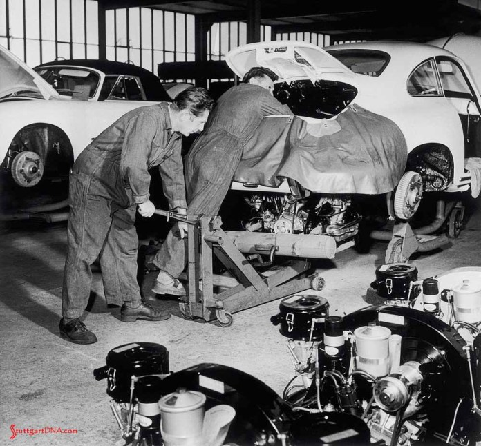"""996-gen Porsche 911 Buyer Guide: """"Hans Sr."""" and """"Franz Sr."""" conducting the marriage of the engine to the chassis and body of a Porsche 356 B, ca. 1960. Credit: Porsche AG"""