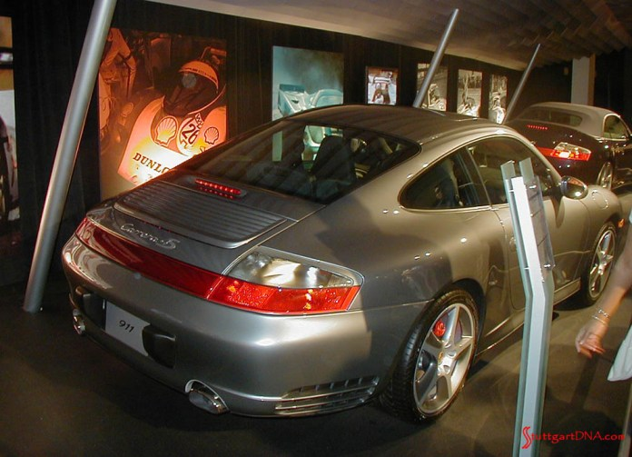996-gen Porsche 911 Buyer Guide: Depicted here in this photo are two gleaming 996-gen Porsche 911 Carreras on display at the 2004 L.A. Auto Show. Credit: StuttgartDNA.com