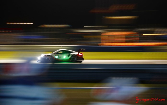Porsche wins 2019 WEC Sebring 1000 Miles: Seen here is the No 91 from its left side at speed on the Sebring track against the surreal nighttime neon blur. Credit: Porsche AG