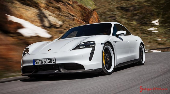 Porsche Taycan first electric sports car world premiere: Depicted here is a gleaming white Taycan Turbo S, left-front, tooling at speed down a windy mountain road. Credit: Porsche AG