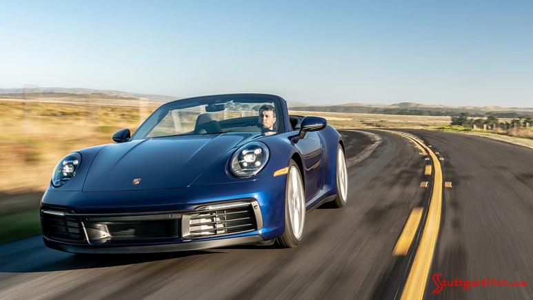 Porsche first-quarter 2021 USA retail sales: Pictured here is a blue 911 Carrera 911 S Cabriolet, seen from the left-front, cruising effortlessly down the highway. Credit: Porsche AG