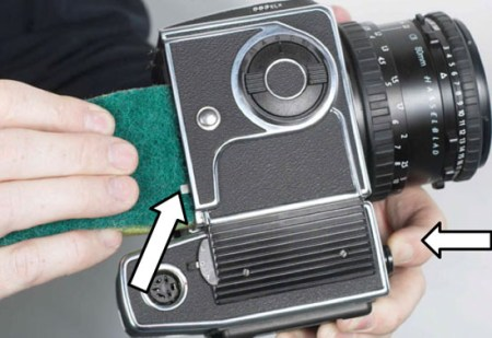 Cleaning the release pin on a Hasselblad body for proper use with a Phase One H20. Source: Phase One knowledgebase