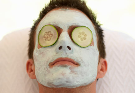 A young man having facial treatment at a health spa